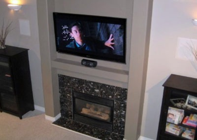 Fireplace TV Mounting, Surround Sound In-wall Front and Rear Speaker Installation, Concealed Wiring. Residential Living Room. London, Ontario -HTAV.