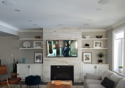 Fireplace TV Mounting, In-ceiling Surround Sound Installation, Concealed Wiring. Front LCR In-ceiling Speakers with directional drivers to direct the audio towards the listening position. Residential Living Room. Waterloo, Ontario -HTAV.
