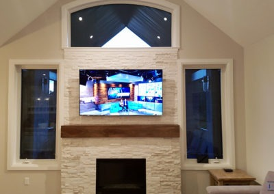 Fireplace TV Mounting, Concealed Wiring. Marquis Developments Model Home, Living Room. Ilderton, Ontario -HTAV.