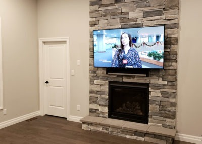"Fireplace TV Mounting, Soundbar Installation, Concealed Wiring. 65"" OLED accompanied by the Sonos playbar. Residential Living Room. London, Ontario -HTAV."