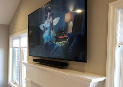 Fireplace TV Mounting, Soundbar Installation, Concealed Wiring. Bose soundbar 500 with wireless Bose bass module 500. Residential Living Room. London, Ontario -HTAV.