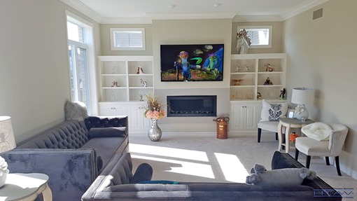 Fireplace Mounted TV Installation, Surround Sound System Setup, Concealed Wiring. London, Ontario.