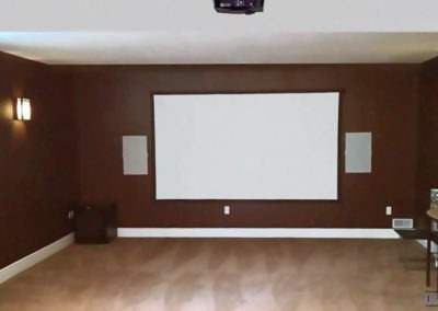 Home Theatre Design and Installation. Projector and Screen Installation, Concealed Wiring, In-wall Surround Sound Installation, Whole Home Audio. Custom Home Theatre with complete Sound Dampening. Residential Basement. London, Ontario -HTAV.