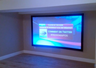 Home Theatre Design and Installation. Projector and Screen Installation, Concealed Wiring, In-wall and In-ceiling Surround Sound Installation. 10 ft curved screen, Dolby Atmos Surround Sound System. Residential Basement. London, Ontario -HTAV.
