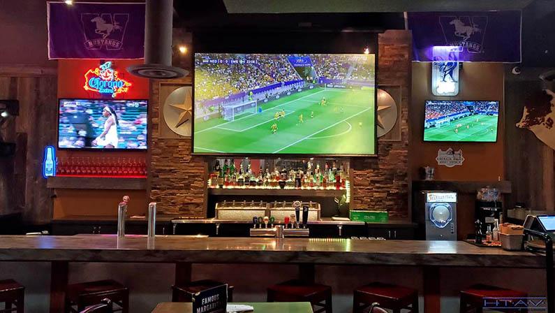 TV Wall Mounting. Lone Star Texas Grill, Bar area. London, Ontario -HTAV.